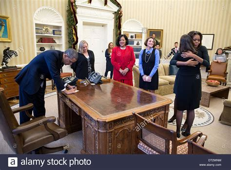 obama resolute desk us president barack obama signs items at the resolute desk after he stock photo 66446960 alamy