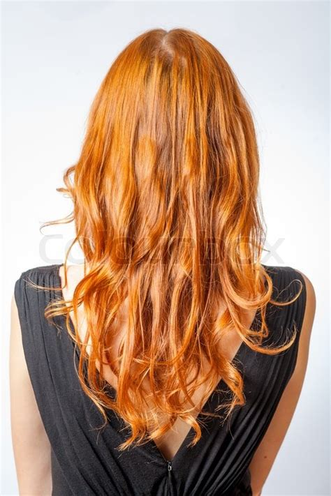 long haircuts with a back view redheads vertical shot of back view of red curly long hair of