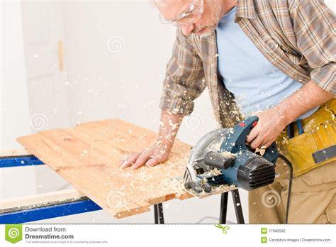 home improvement handyman cut wood with jigsaw stock