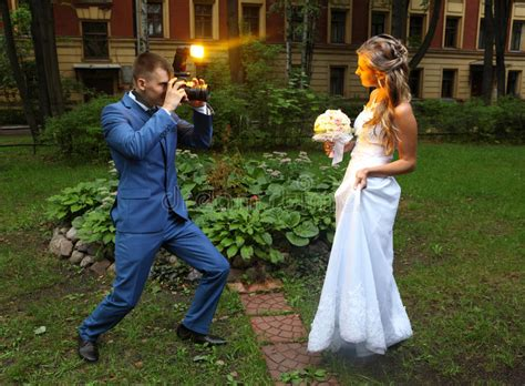 Taking Wedding Pictures by Wedding Photographer Taking Picture Flash