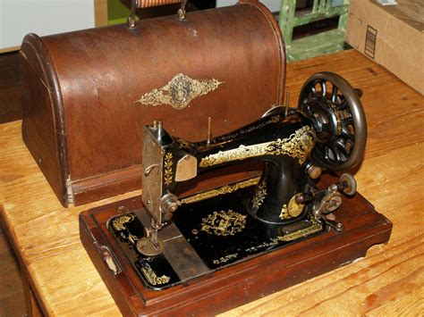 antique singer crank sewing machine  wood base