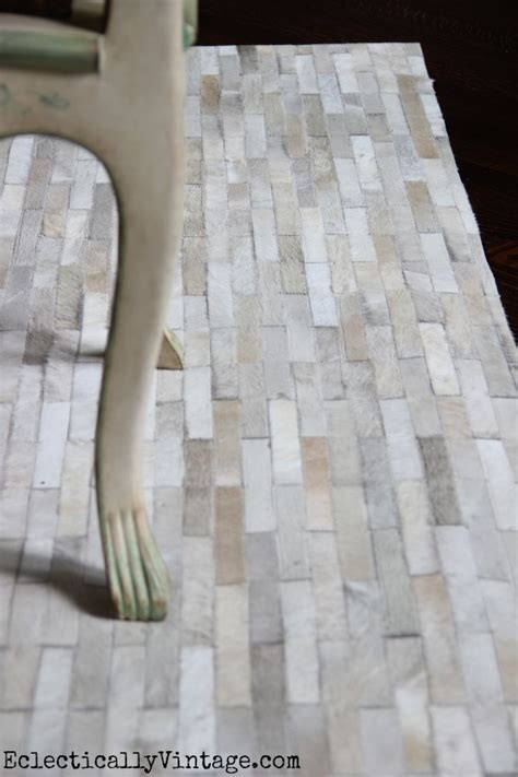Pieced Cowhide Rug Dining Room Update With A Pieced Cowhide Rug