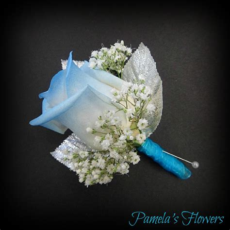 light blue and white roses a white full size rose tipped light blue accented with