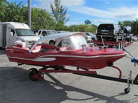 sea king boats  red fish antique classic boat