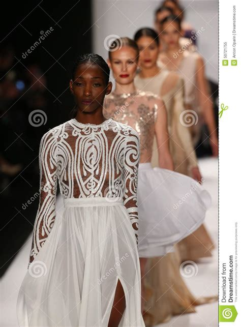 the painting fashion show models walk the runway in a walter mendez design at the