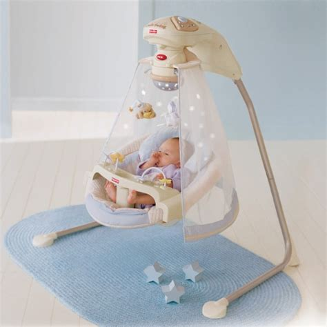 swinging a baby fisher price starlight cradle baby swing baby swings at