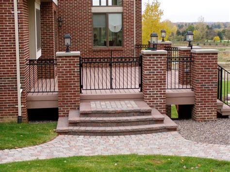 deck  brick pillars metal railing  gate  paver