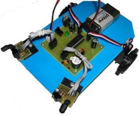 Fiting Lu Sensor obstacle avoiding robot with servo motors