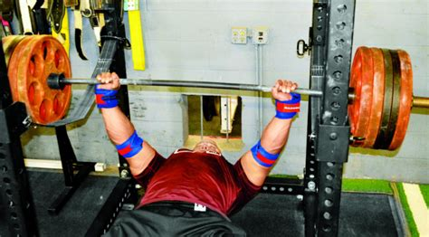 big bench workout strength building tips mark bell s bigger bench workout