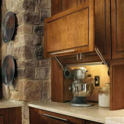 kitchen cabinet garage door kraftmaid appliance garage home pinterest