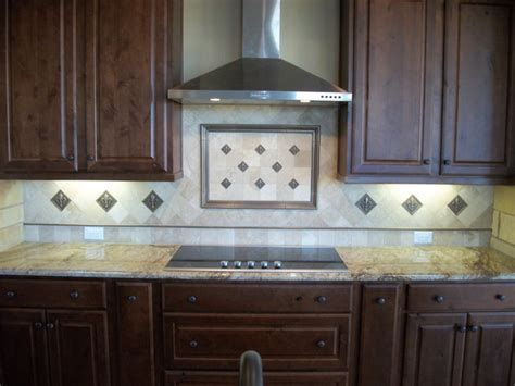 framed backsplash with fleur de lis traditional