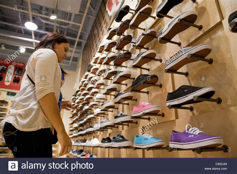sneaker shops usa looking at shoes in a shoe shop vans
