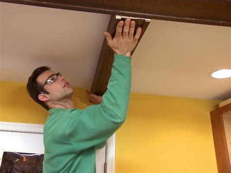 how to install wood beams on a ceiling how to install faux ceiling beams how tos diy