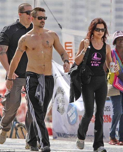 shirtless colin farrell shows his fading tattoos on cannes