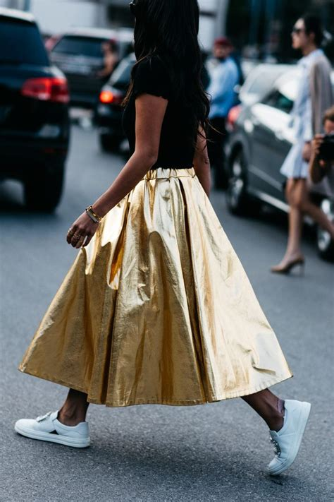 skirt gold paired with sneakers street style 224 la