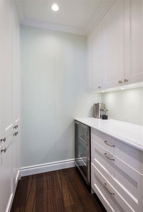 White Kitchen Pantry Cabinets with Blue Walls Paint Color