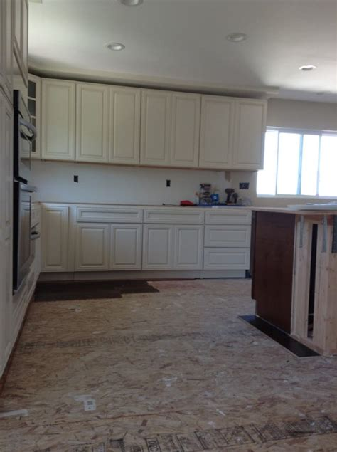 should i have a tv in my kitchen or not should i use two different color countertops in my kitchen