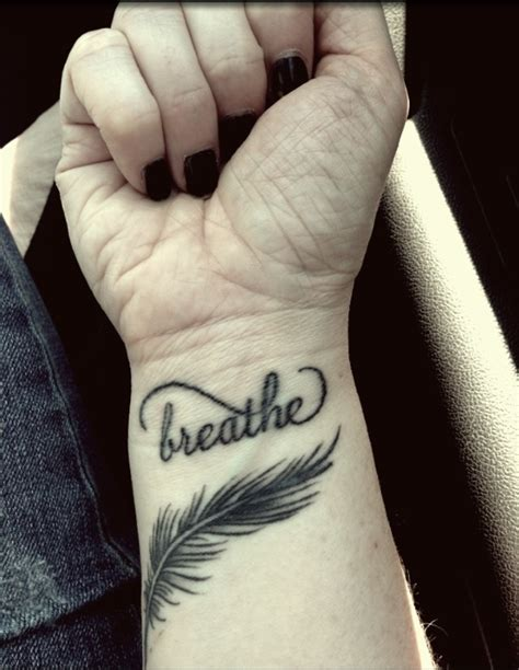 wrist feather tattoos 57 attractive wrist feather tattoos