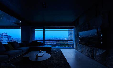 black acrylic glass  stone form  dark  sophisticated apartment interior