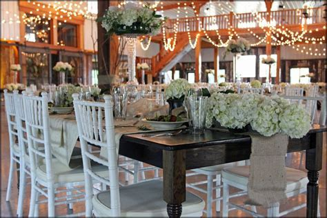 Our farm tables and white chiavari chairs matched for a