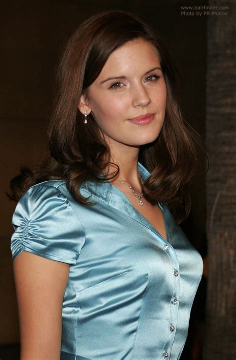 maggie grace sporting  long hairstyle  wearing  blue