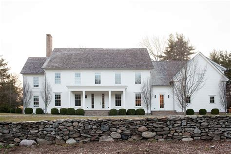 A modernized version of a new england farmhouse in connecticut