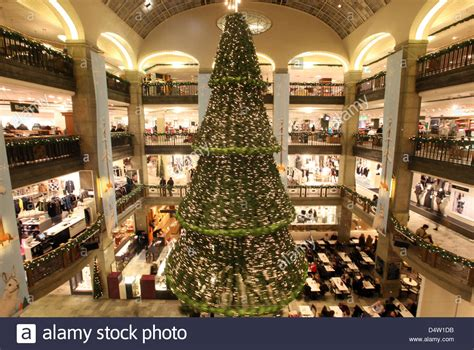 a giant christmas tree hangs from the ceiling of a