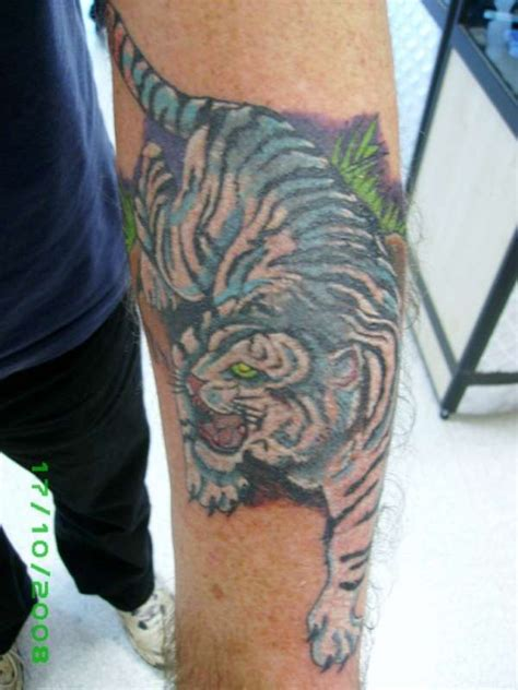 queenstown tattoo white tiger white tiger mens arm tattoo