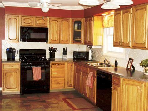 kitchen color ideas  oak cabinets  black appliances
