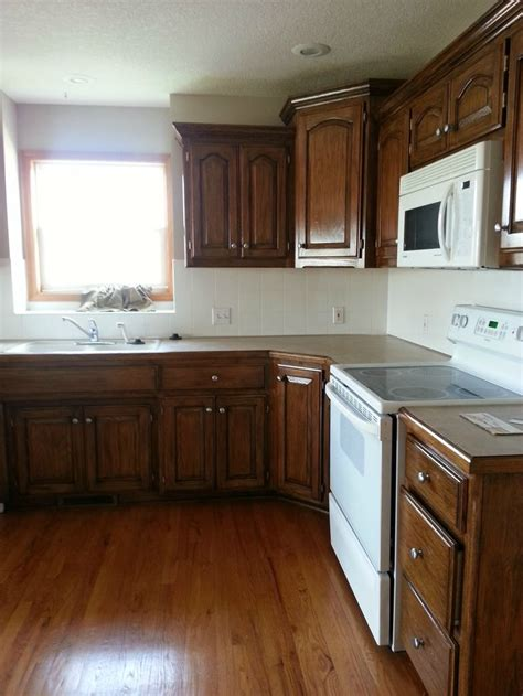 restaining oak kitchen cabinets 17 best ideas about oak kitchens on pinterest craftsman
