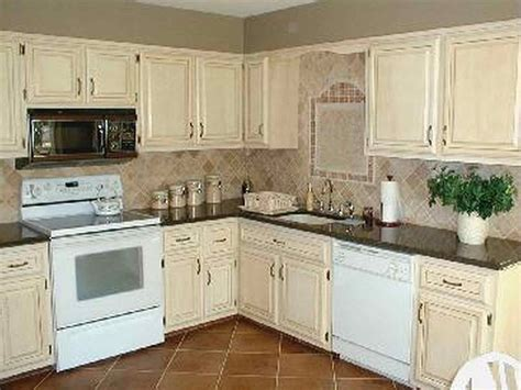 painting cherry cabinets white painting wood cabinets white in kitchen deductour com