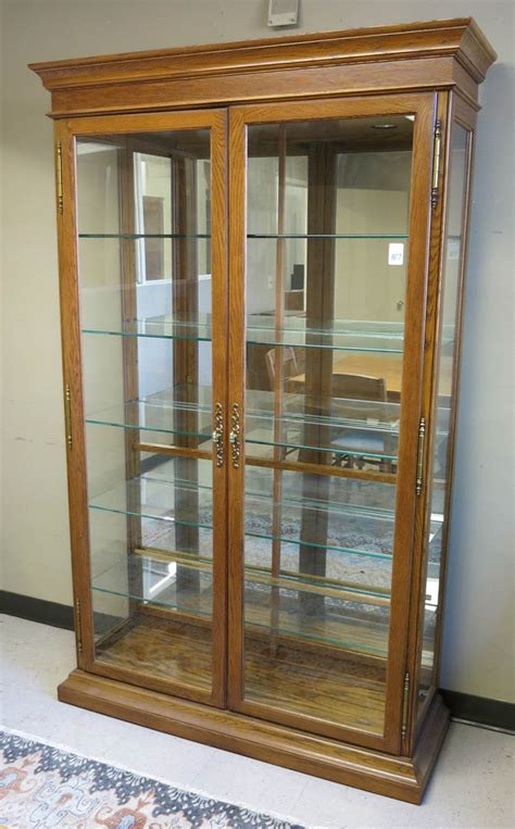 modern oak cabinets modern oak and glass illuminated display cabinet
