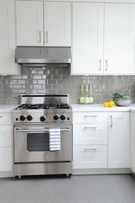 grey tile floors white cabinets white kitchen with gray floor tiles design ideas