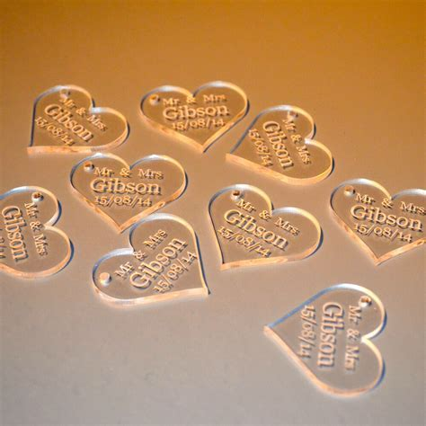 Personalised Clear Acrylic Hearts   4cm Wide. Table