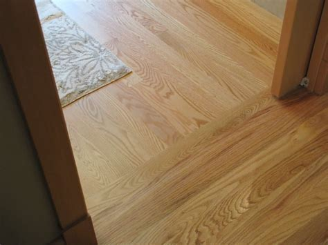 Distinctive Hardwood Floor Transition from Room to Room
