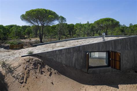 concrete roof house plans concrete house buried under artificial sand dunes modern
