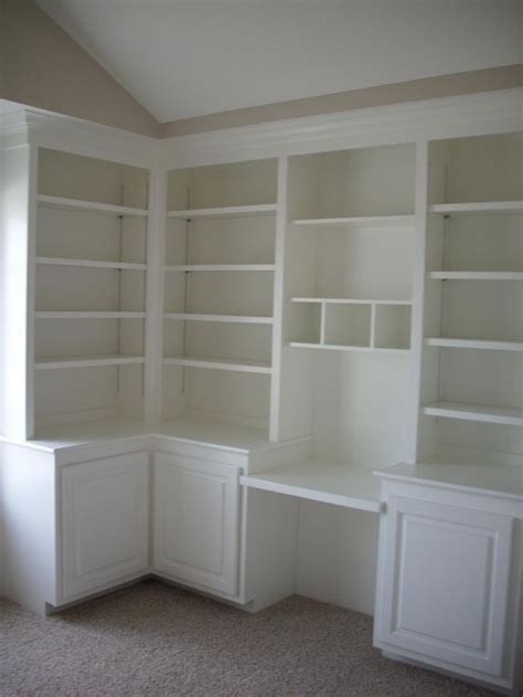 built in shelves and desk bedroom storage