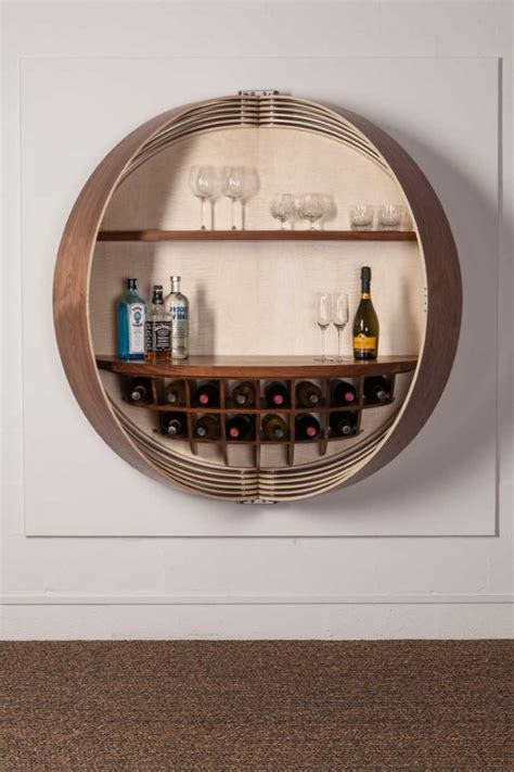 A Wall Mounted Bar Cabinet Inspired By A Spinning Coin Wall Mounted Bar Cabinets For Home