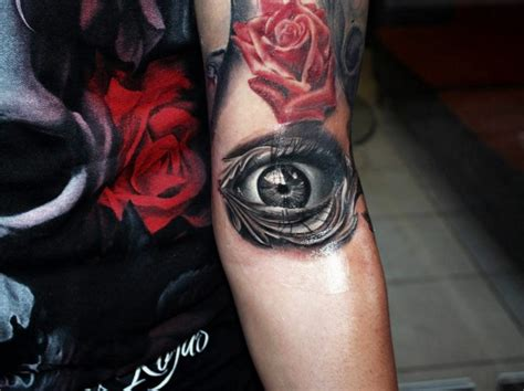 tattoo eye on arm 3d style black and white arm tattoo of human eye and red