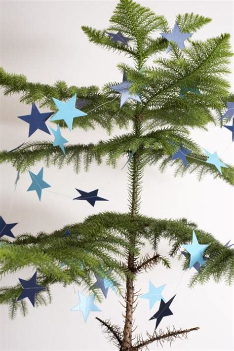 photo  sparsely decorated natural pine christmas tree  christmas images