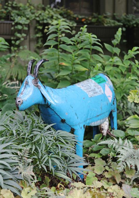 Blue Goat why yes i did just buy a large blue metal goat stately kitsch
