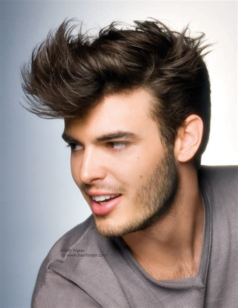 Modern men's haircut, tapered at the temple and around the