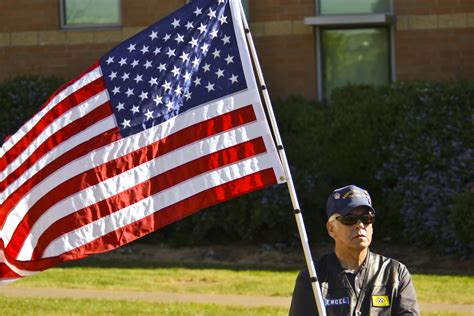 An American And File A Member Of The Patriot Guard Riders Holding An American Flag Jpg Wikimedia Commons