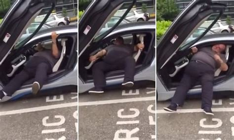 bmw driver  video struggles      slung  friends laugh daily mail