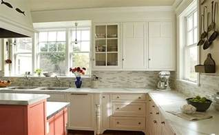 backsplash with white kitchen cabinets