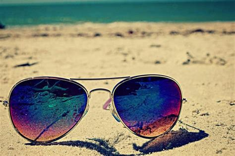 sunglasses on the beach pictures photos and images for