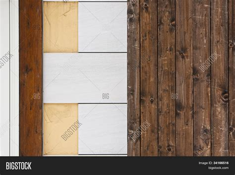 faux wood planks get a trending stone wall look wall wood plank fake stone tiles image photo bigstock