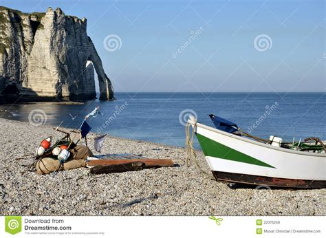 pebble art fishing boat small boat on pebble beach of etretat in france royalty