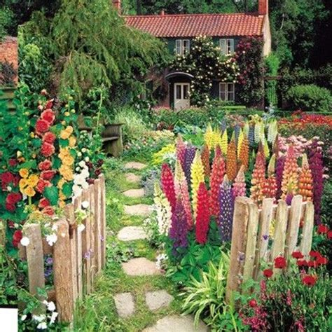 A Garden I M In Love With Cobblestone Path Picket Fence Study Of Flower Colours In The Garden