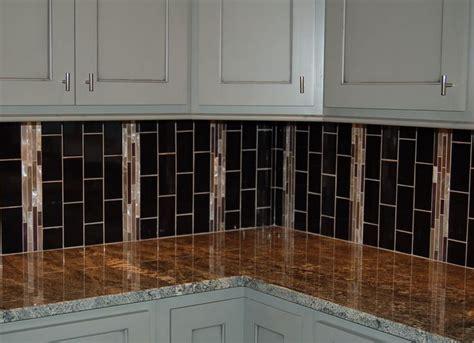 vertical subway tile backsplash pin by mccoy homes inc on kitchens